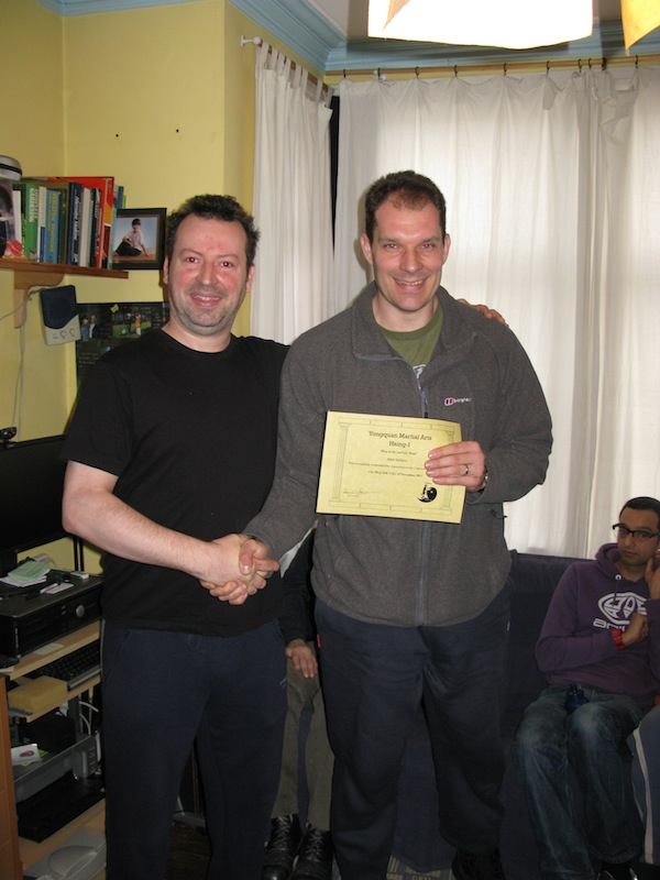Alex Sellars receiving his level 3 from Sifu Smith